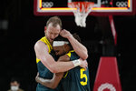 Australia's Joe Ingles (7) and Patty Mills (5) react after beating Slovenia 107-93 during the men's bronze medal basketball game at the 2020 Summer Olympics, Saturday, Aug. 7, 2021, in Tokyo, Japan. (AP Photo/Eric Gay)