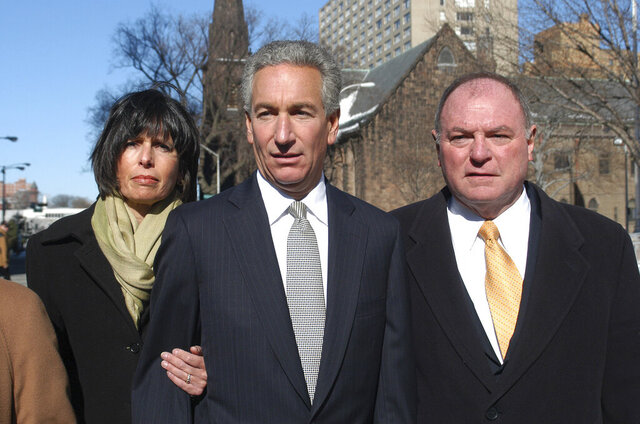 FILE - In this March 4, 2005 file photo, Charles B. Kushner, flanked by his wife, Seryl Beth, left, and his attorney Alfred DeCotiis arrives at the Newark Federal Court for sentencing in Newark, N.J. President Donald Trump on Wednesday, Dec. 23, 2020 issued pardons and sentence commutations for 29 people, including former campaign chairman Paul Manafort and Charles Kushner, the father of his son-in-law, in the latest burst of clemency in his final weeks at the White House. (AP Photo/Marko Georgiev, File)