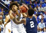Kentucky's Nick Richards, left, is pressured by Mount St. Mary's Jalen Gibbs (2) during the first half of an NCAA college basketball game in Lexington, Ky., Friday, Nov. 22, 2019. (AP Photo/James Crisp)