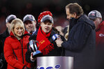 Clark Hunt, chairman and CEO of the Kansas City Chiefs, center, and his mother Norma Clark, left, speak after the NFL AFC Championship football game against the Tennessee Titans Sunday, Jan. 19, 2020, in Kansas City, MO. The Chiefs won 35-24 to advance to Super Bowl 54. (AP Photo/Charlie Neibergall)