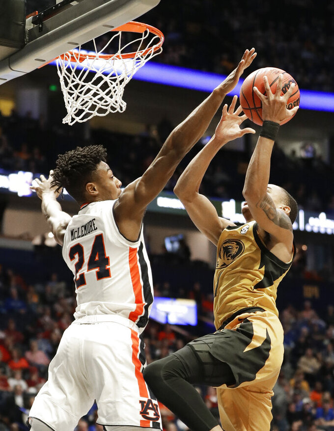 Auburn forward Anfernee McLemore (24) defends against Missouri guard Xavier Pinson in the first half of an NCAA college basketball game at the Southeastern Conference tournament Thursday, March 14, 2019, in Nashville, Tenn. (AP Photo/Mark Humphrey)