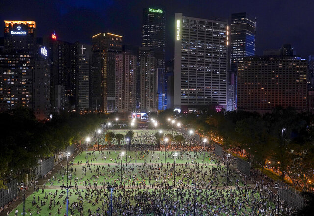 In this aerial view, participants start to gather for a vigil to remember the victims of the 1989 Tiananmen Square Massacre, despite permission for it being officially denied, at Victoria Park in Causeway Bay, Hong Kong, Thursday, June 4, 2020. China is tightening controls over dissidents while pro-democracy activists in Hong Kong and elsewhere try to mark the 31st anniversary of the crushing of the pro-democracy movement in Beijing's Tiananmen Square.(AP Photo/Vincent Yu)