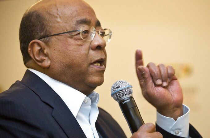 """FILE - In this Monday, March 2, 2015 file photo, Mo Ibrahim, Chairman and Founder of the Mo Ibrahim Foundation, answers a question from a journalist at a press conference where the winner of the 2014 Ibrahim Prize for Achievement in African Leadership was announced, in Nairobi, Kenya. Ibrahim, in a June 2021 interview with The Associated Press, is sharply criticizing the hoarding of COVID-19 vaccines by wealthy nations, urging the international community to """"walk the talk"""" of equitable distribution as Africa desperately lags behind. (AP Photo/Ben Curtis, File)"""