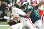 Philadelphia Eagles nose tackle Javon Hargrave (97) sacks Atlanta Falcons quarterback Matt Ryan (2) during the second half of an NFL football game, Sunday, Sept. 12, 2021, in Atlanta. (AP Photo/Brynn Anderson)