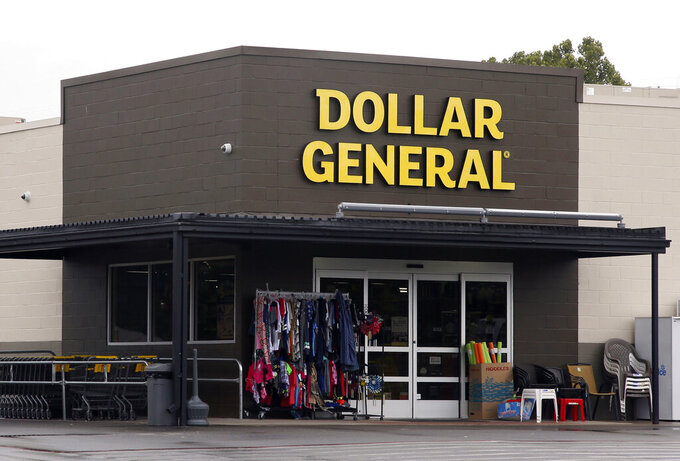 FILE- In this Aug. 3, 2017, file photo the Dollar General store is pictured in Luther, Okla.  As vaccinations continue across the U.S., some companies are offering financial incentives to encourage their workers to get the shots. Dollar General is one of the first major companies to announce extra pay for workers who get vaccinated. The Tennessee-based retailer said Wednesday, Jan. 13, 2021  it will give employees the equivalent of four hours of pay if they get the vaccine.    (AP Photo/Sue Ogrocki, File)
