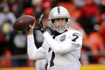 FILE - In this Dec. 1, 2019, file photo, Oakland Raiders quarterback Mike Glennon (7) warms up before an NFL football game against the Kansas City Chiefs in Kansas City, Mo. The Jacksonville Jaguars have agreed to terms with journeyman quarterback Mike Glennon, giving them a veteran backup behind Gardner Minshew. (AP Photo/Charlie Riedel, File)