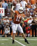 FILE - In this Saturday, Oct. 13, 2018, file photo, Texas quarterback Sam Ehlinger (11) throws against Baylor during the first half of an NCAA college football game in Austin, Texas. After years of being a late-season afterthought, Texas coach Tom Herman wanted the Longhorns to be competing for a Big 12 title in November. Texas is right where he wanted, with a key matchup against West Virginia to see just how long they stay there.  (AP Photo/Eric Gay, File)