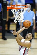 UNLV guard Marvin Coleman (31) goes up for a basket in the first half of an NCAA college basketball game against North Carolina in the Maui Invitational tournament, Monday, Nov. 30, 2020, in Asheville, N.C. (AP Photo/Kathy Kmonicek)