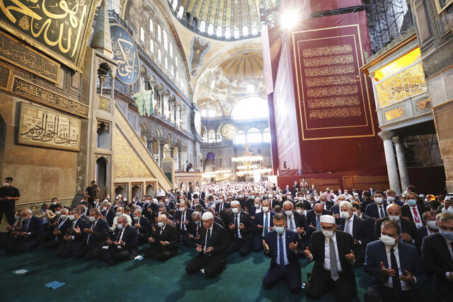 Turkey's President Recep Tayyip Erdogan, centre, takes part in Friday prayers in Hagia Sophia, at the historic Sultanahmet district of Istanbul, Friday, July 24, 2020. Fulfilling a dream of his Islamic-oriented youth, Erdogan joined hundreds of worshipers for the first Muslim prayers in 86 years inside the Istanbul landmark that served as one of Christendom's most significant cathedrals, a mosque and a museum before its conversion back into a Muslim place of worship. The conversion of the edifice, has led to an international outcry. (Turkish Presidency via AP, Pool)