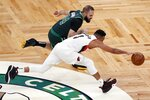 Boston Celtics' Evan Fournier (94) and Portland Trail Blazers' CJ McCollum (3) battle for a loose ball during the second half of an NBA basketball game, Sunday, May 2, 2021, in Boston. (AP Photo/Michael Dwyer)