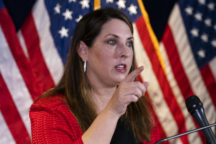 "FILE - In this Nov. 9, 2020 file photo, Republican National Committee chairwoman Ronna McDaniel speaks during a news conference at the Republican National Committee in Washington. The head of the Republican National Committee is declining to encourage former President Donald Trump to run for the White House in 2024. RNC Chairwoman Ronna McDaniel told The Associated Press on Wednesday that the party would stay ""neutral"" in its next presidential primary. (AP Photo/Alex Brandon)"