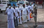 Representatives of candidates wait to enter a vote counting center for the state legislature elections amid a weekend lockdown to curb the spread of coronavirus Kochi, Kerala state, India, Sunday, May 2, 2021. (AP Photo/R S Iyer)