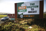 "FILE - In this Wednesday Oct. 16, 2019 file photo motorists pass along the old Belfast to Dublin road close to the Irish border in Newry, Northern Ireland. The chaotic scenes during a week of violence on the streets of Northern Ireland have stirred memories of decades of Catholic-Protestant conflict, known as ""The Troubles."" A 1998 peace deal ended large-scale violence but did not resolve Northern Ireland's deep-rooted tensions. (Photo/Peter Morrison, File)"