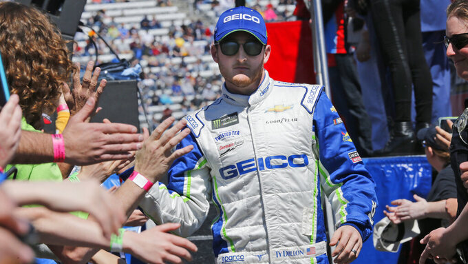 NASCAR Cup Series driver Ty Dillon (13) greets fans during driver introductions prior to the NASCAR Cup Series auto race at the Martinsville Speedway in Martinsville, Va., Sunday, March 24, 2019. (AP Photo/Steve Helber)
