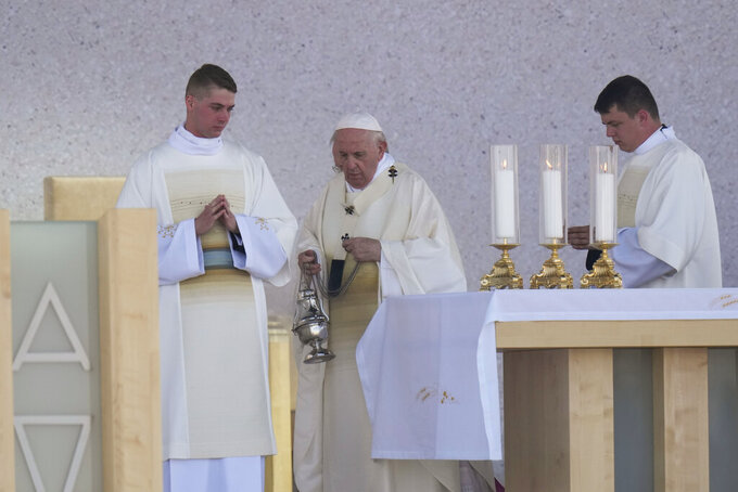 Pope Francis celebrates a Mass in the esplanade of the National Shrine in Sastin, Slovakia, Wednesday, Sept. 15, 2021. Pope Francis celebrated an open air Mass in Sastin, the site of an annual pilgrimage each September 15 to venerate Slovakia's patron, Our Lady of Sorrows. (AP Photo/Petr David Josek)