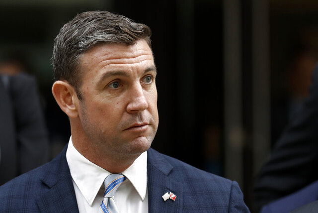FILE - In this Dec. 3, 2019 file photo, California Republican Rep. Duncan D. Hunter leaves federal court in San Diego. Hunter has indicated he's on his way out of office after pleading guilty to a corruption charge, a break for California's beleaguered GOP that increases the chances the party keeps one of its few remaining House seats in the heavily Democratic state. But Hunter's pending departure also comes with a measure of uncertainty. There is no clear Republican favorite to succeed him in the San Diego County district, setting the stage for several months of party infighting in a race that could turn on local political loyalties or the potential involvement of President Donald Trump. (AP Photo/Gregory Bull, File)