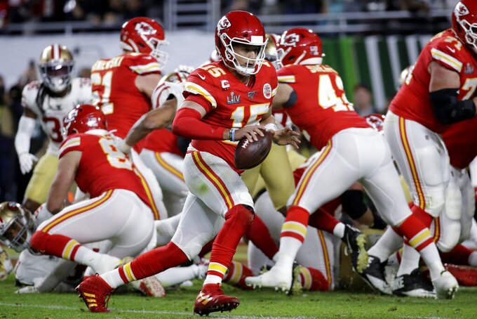 Kansas City Chiefs quarterback Patrick Mahomes (15) runs for a touchdown against the San Francisco 49ers during the first half of the NFL Super Bowl 54 football game Sunday, Feb. 2, 2020, in Miami Gardens, Fla. (AP Photo/Patrick Semansky)