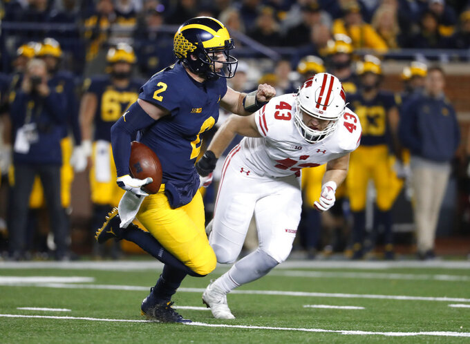 Michigan quarterback Shea Patterson (2) runs from Wisconsin linebacker Ryan Connelly (43) in the first half of an NCAA college football game in Ann Arbor, Mich., Saturday, Oct. 13, 2018. (AP Photo/Paul Sancya)