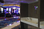 Hand washing stations have been installed in the casino area as a coronavirus safety measure at the closed Bellagio hotel and casino, Wednesday, May 20, 2020, in Las Vegas. Casino operators in Las Vegas are awaiting word when they will be able to reopen after a shutdown during the coronavirus outbreak. (AP Photo/John Locher)