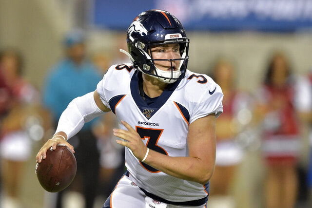 FILE - In this Aug. 1, 2019, file photo, Denver Broncos quarterback Drew Lock scrambles during the second half of the Pro Football Hall of Fame NFL preseason game against the Atlanta Falcons in Canton, Ohio. The Broncos are increasing rookie quarterback Drew Lock's workload at practice this week to determine if he should get his first NFL start against the Chargers this weekend. (AP Photo/David Richard, File)