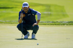 Louis Oosthuizen, of South Africa, lines up a putt on the second green during the third round of the US Open Golf Championship, Saturday, Sept. 19, 2020, in Mamaroneck, N.Y. (AP Photo/John Minchillo)