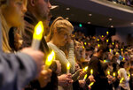 People gather to pray for the victims of a mass shooting during a candlelight vigil in Thousand Oaks, Calif., Thursday, Nov. 8, 2018. A gunman opened fire Wednesday evening inside a country music bar, killing multiple people including a responding sheriff's sergeant. (AP Photo/Ringo H.W. Chiu)