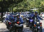 Houston Police officers escort the body of Sgt. Harold Preston from Memorial Hermann Hospital to the medical examiner's office, Tuesday, Oct. 20, 2020, in Houston. Two officers were shot by a suspect during a domestic violence call at an apartment complex Tuesday. The other officer Courtney Waller was shot in the arm and is in stable condition at a hospital. ( Godofredo A. Vásquez/Houston Chronicle via AP)