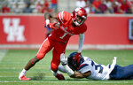 Houston quarterback Bryson Smith (1) is tackled by Arizona safety Xavier Bell during the first half of an NCAA college football game, Saturday, Sept. 8, 2018, in Houston. (AP Photo/Eric Christian Smith)