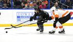 Tampa Bay Lightning center Brayden Point (21) handles the puck against Philadelphia Flyers defenseman Travis Sanheim (6) during the second period of an NHL hockey game Saturday, Feb. 15, 2020, in Tampa, Fla. (AP Photo/Jason Behnken)