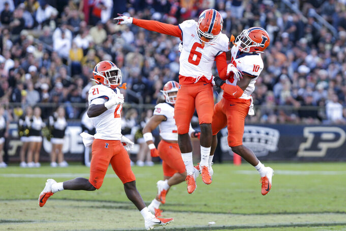 Illinois wide receivers Deuce Spann (6) and Desmond Dan Jr. (10) celebrate during the fourth quarter of an NCAA college football game against Purdue, Saturday, Sept. 25, 2021, in West Lafayette, Ind. (Nikos Frazier/Journal & Courier via AP)
