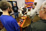 Ken Sann pours juice before those in attendance at Angels of Hope Metropolitan Community Church have communion Sunday, Aug. 18, 2019 in Kaukauna, Wis.. (Danny Damiani/The Post-Crescent via AP)