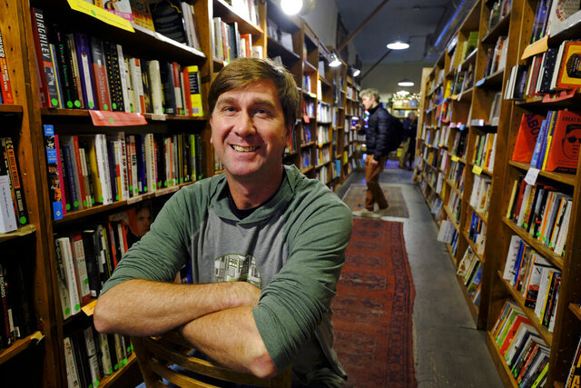 In this Wednesday, Dec. 4, 2019, photo Pete Mulvihill poses for a photo in  his Browser Books store that he recently opened in San Francisco. Mulvihill has felt optimistic enough about being an independent bookseller that he bought a third store within the past two months. (AP Photo/Eric Risberg)