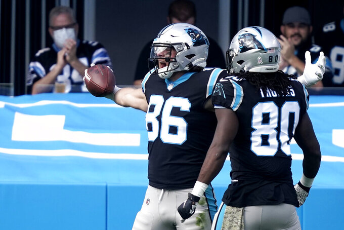 Carolina Panthers tight end Colin Thompson (86) celebrates his touchdown catch in the end zone against the Tampa Bay Buccaneers during the first half of an NFL football game, Sunday, Nov. 15, 2020, in Charlotte , N.C. (AP Photo/Gerry Broome)