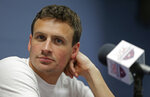 FILE - In this May 12, 2016, file photo, Ryan Lochte listens to a question from the media in Charlotte, N.C. Lochte's attorney says the swimmer is seeking help for poor decision making that occurs when alcohol is involved, but the 12-time Olympic medalist is not in a treatment facility and he continues to train for a shot at the 2020 Tokyo Games.  (AP Photo/Chuck Burton, File)