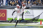 UNLV wide receiver Mekhi Stevenson (2) celebrates with teammate Jacob Gasser (82) after making a catch in the end zone for a touchdown against Nevada in the first half of an NCAA college football game in Reno, Nev., Saturday, Nov. 30, 2019. (AP Photo/Tom R. Smedes)