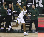 Baylor guard Jared Butler (12) reacts after score a three point shot against Oklahoma State in the second half of an NCAA college basketball game, Thursday, March 4, 2021, in Waco, Texas. (AP Photo/Jerry Larson)