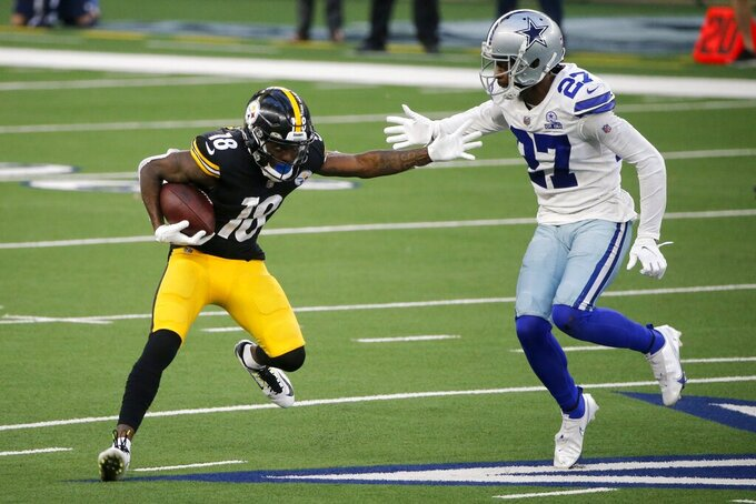 Pittsburgh Steelers wide receiver Diontae Johnson (18) catches a pass for a first down in front of Dallas Cowboys cornerback Trevon Diggs (27) in the first half of an NFL football game in Arlington, Texas, Sunday, Nov. 8, 2020. (AP Photo/Michael Ainsworth)