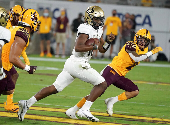 Colorado State quarterback Brendon Lewis (12) runs for a first down against Arizona State's defensive during the first half of an NCAA college football game Saturday, Sept 25, 2021, in Tempe, Ariz. (AP Photo/Darryl Webb)