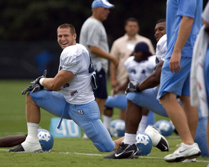 """North Carolina linebacker Chase Rice smiles as he goes through stretching exercises with his teammates during practice in Chapel Hill, N.C., on Thursday Aug. 7, 2008. Chase Rice had his sights set on the NFL. Then the linebacker who tore up the ACC in 2006 tore up his left ankle in the season opener as a junior. It worked out pretty well for Rice in another area of entertainment. His current hit is a pairing with Florida Georgia Line: """"Drinkin' Beer. Talkin' God. Amen."""" (Robert Willett/The News & Observer via AP)"""