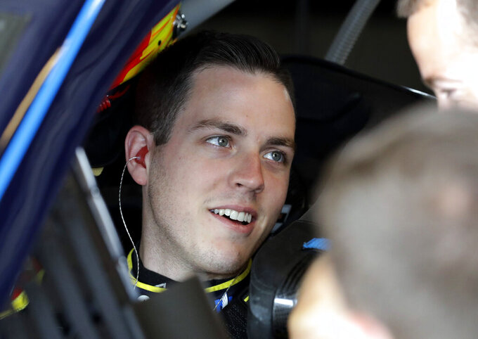 Alex Bowman talks with his crew members during a practice for the NASCAR Sprint Cup Series auto race at Chicagoland Speedway in Joliet, Ill., Saturday, June 29, 2018. (AP Photo/Nam Y. Huh)
