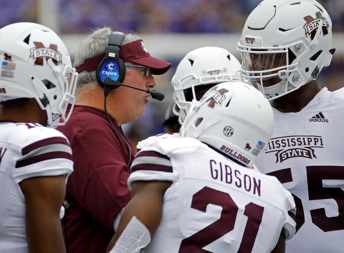 Mississippi State head coach Joe Moorhead talks to his players during the second half of an NCAA college football game against Kansas State Saturday, Sept. 8, 2018, in Manhattan, Kan. Mississippi State won 31-10. (AP Photo/Charlie Riedel)