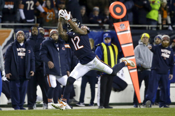 FILE - In this Jan. 6, 2019, file photo, Chicago Bears wide receiver Allen Robinson (12) makes a reception during the second half of an NFL wild-card playoff football game against the Philadelphia Eagles in Chicago. Bears quarterback Michael Trubisky has something he didn't early last year with a healthy wide receiver Allen Robinson. Now two years removed from ACL surgery, Robinson has developed into a favorite big-play target.  (AP Photo/David Banks, File)