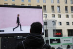 A giant screen streams a Prada fashion live show during the Milan's fashion week in Milan, Italy, Sunday, Jan. 17, 2021. (AP Photo/Luca Bruno)