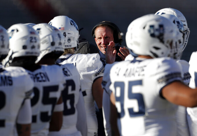 Utah State coach Gary Andersen cheers to his players during a timeout in the first half of an NCAA college football game against New Mexico on Saturday, Nov. 30, 2019 in Albuquerque, N.M. (AP Photo/Andres Leighton)