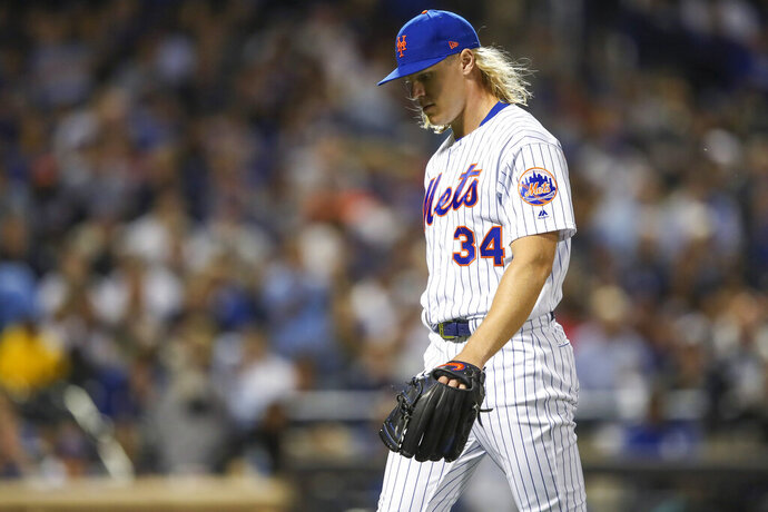 New York Mets starting pitcher Noah Syndergaard walks off the field after the top of the fourth inning of the team's baseball game against the Los Angeles Dodgers, Friday, Sept. 13, 2019, in New York. (AP Photo/Mary Altaffer)