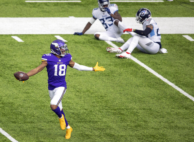 Minnesota Vikings wide receiver Justin Jefferson celebrates after a 71-yard touchdown during the third quarter of an NFL football games against the Tennessee Titans,  Sunday, Sept. 27, 2020 in Minneapolis. (Elizabeth Flores/Star Tribune via AP)