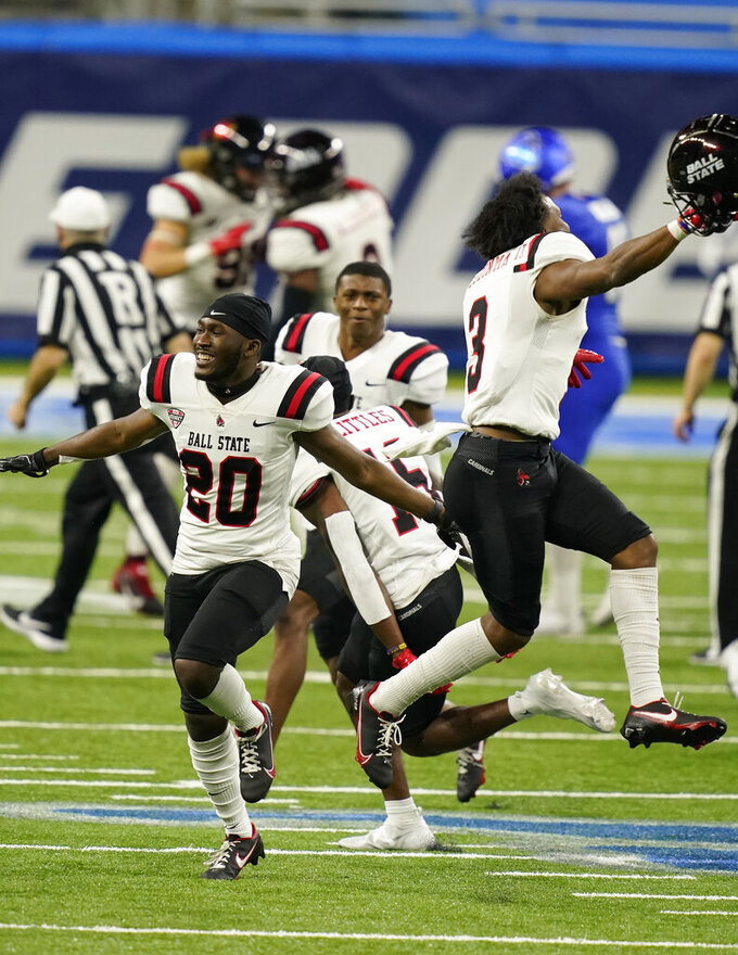 Ball State players run onto the field after the team defeated Buffalo during the Mid-American Conference championship NCAA college football game, Friday, Dec. 18, 2020 in Detroit. (AP Photo/Carlos Osorio)