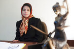 """FILE - In this Nov. 1, 2008 file photo, Iranian human rights lawyer Nasrin Sotoudeh, poses for a photograph in her office in Tehran, Iran. The imprisoned Iranian human rights lawyer Nasrin Sotoudeh and the prominent Belarus opposition figure Ales Bialiatski have been awarded the 2020 Swedish Right Livelihood Award, sometimes referred to as the """"Alternative Nobel,"""" along with activists from Nicaragua and the United States. (AP Photo/Arash Ashourinia, File)"""