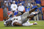 Charleston Southern quarterback London Johnson (1) is sacked by Florida defensive back Chauncey Gardner-Johnson (23) for a 7-yard loss during the first half of an NCAA college football game Saturday, Sept. 1, 2018, in Gainesville, Fla. (AP Photo/Phelan M. Ebenhack)