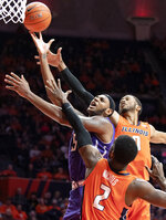 Northwestern center Dererk Pardon (5) shoots under pressure from Illinois forward Kipper Nichols (2) and guard Alan Griffin (0) during the second half of an NCAA college basketball game in Champaign, Ill., Sunday, March 3, 2019. (AP Photo/Stephen Haas)